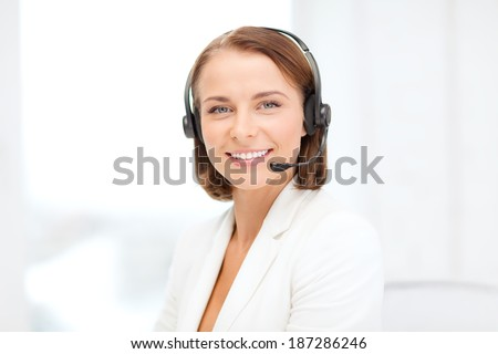 business, communication and call center concept - smiling female helpline operator with headphones in call center - stock photo