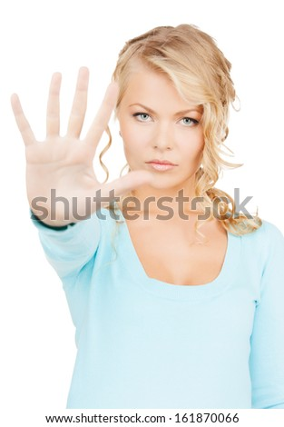 business, communication concept - bright picture of young woman making stop gesture - stock photo