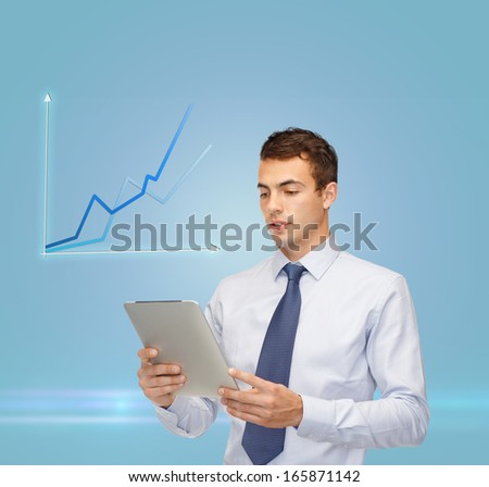 business, communication, modern technology and office concept - buisnessman with tablet pc and graph - stock photo