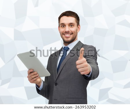business, communication, modern technology and office concept - smiling businessman with tablet pc computer showing thumbs up over gray graphic low poly background - stock photo