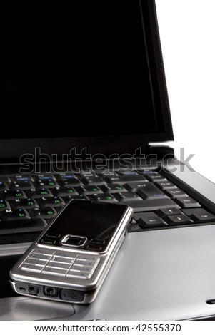 business communications - laptop and cell mobile phone on a desktop