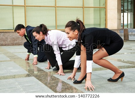 Business competition: businesspeople ready for start - stock photo