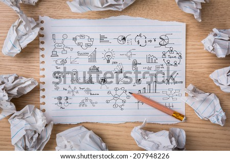 Business concept and graph drawing on White note book paper with  pencil and crumpled paper - stock photo
