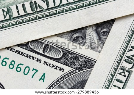 Business concept -  banknotes and Franklin looking from one of them