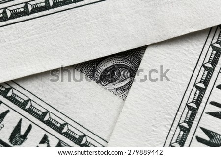 Business concept -  banknotes and Franklin looking from one of them - stock photo