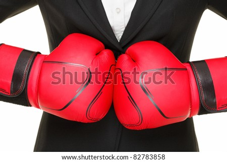 business concept - boxing gloves and suit. Businesswoman punching red boxing gloves together isolated on white background. - stock photo