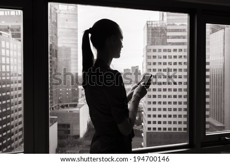 Business concept - Business woman using mobile phone in the office. - stock photo