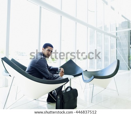 Business concept - businessman alone in office building - stock photo