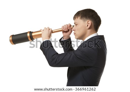 Business concept. Businessman looks through a telescope isolated on white