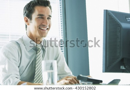 Business concept - businessman working in office