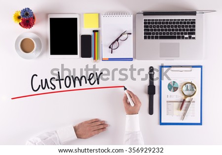 Business Concept: Businessman writing the words CUSTOMER - stock photo