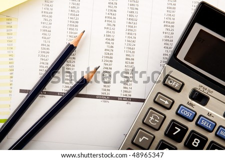 business concept, calculator and pencils - stock photo