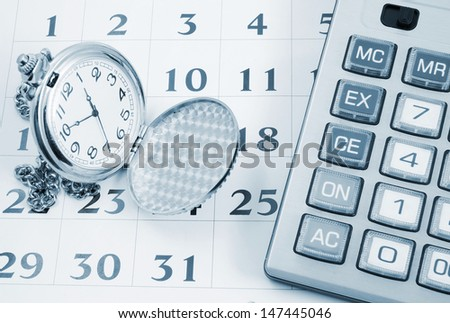 Business concept, calculator and watch on calendar