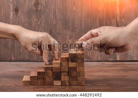 Business Concept, climbing the career stairs drawn to success on wooden board with copy space - stock photo