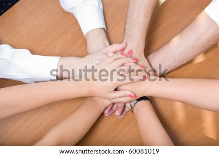 Business concept. Close-up of many hands all together demonstrating the unity and team work among business people working in the big company, firm or enterprise.