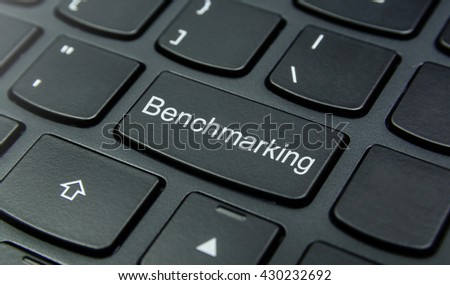 Business Concept: Close-up the Benchmarking button on the keyboard and have Black color button isolate black keyboard - stock photo