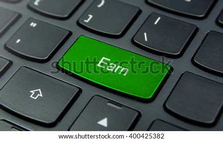 Business Concept: Close-up the Earn button on the keyboard and have Lime, Green color button isolate black keyboard