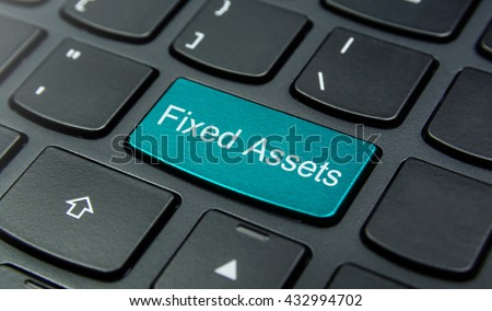 Business Concept: Close-up the Fixed Assets button on the keyboard and have Azure, Cyan, Blue, Sky color button isolate black keyboard - stock photo