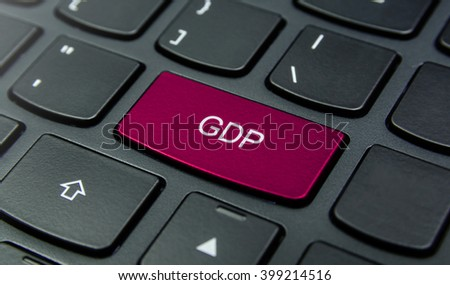 Business Concept: Close-up the GDP button on the keyboard and have Magenta color button isolate black keyboard