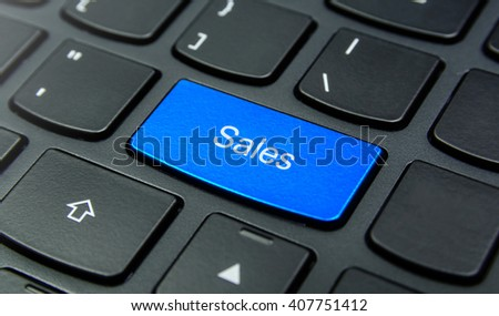 Business Concept: Close-up the Sales button on the keyboard and have Azure, Cyan, Blue, Sky color button isolate black keyboard