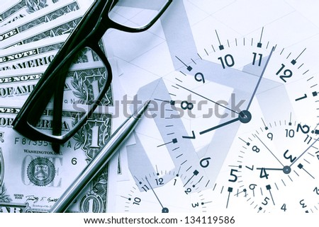 Business concept. Dollar bank notes and clock face on background with business chart