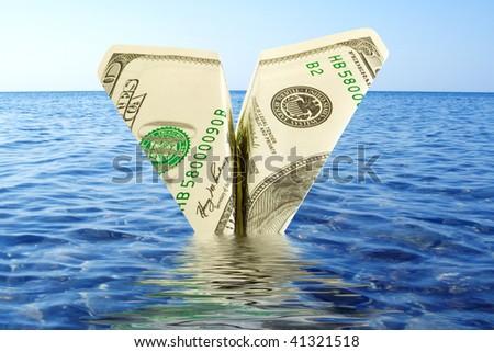 business concept. fall of money plane over blue sky - stock photo