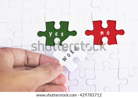 Business Concept - Female hand and missing puzzle with WORK, YES and no WORD