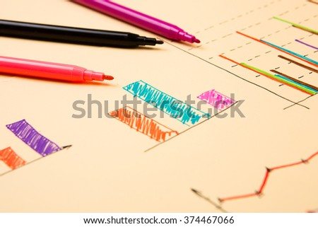 Business concept - Financial graphs drawn with colored pens