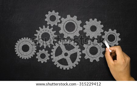business concept: gears hand drawn on chalkboard - stock photo