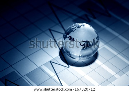 Business concept. Glass globe on background with diagram - stock photo