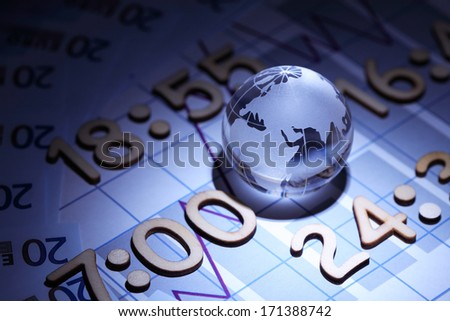 Business concept. Glass globe on background with diagram and numbers as time - stock photo