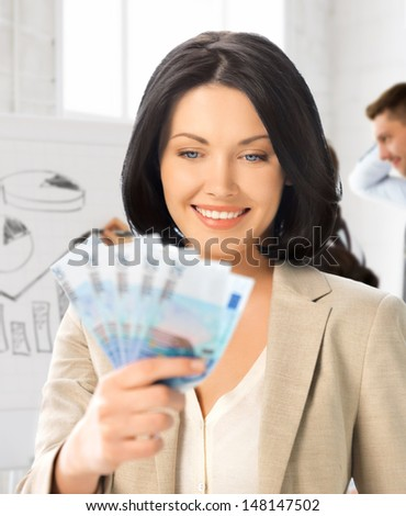 business concept - happy businesswoman with cash money in office - stock photo