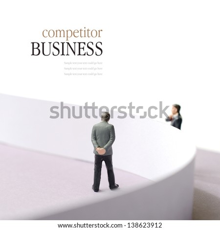 Business concept image depicting a competitor situation. Two businessmen divided by a wall. Copy space. - stock photo