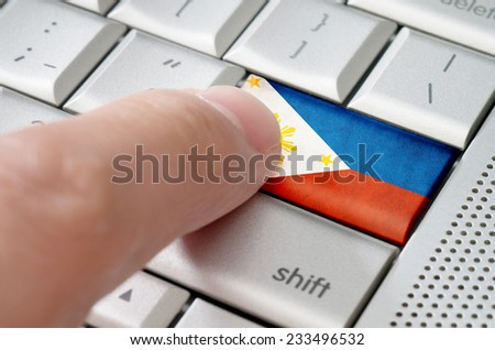 Business concept male finger pressing Philipines enter key on metallic keyboard - stock photo