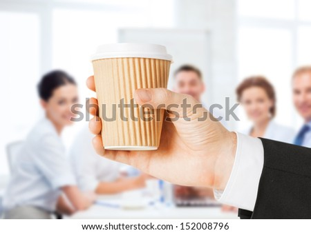 business concept - man holding take away coffee cup - stock photo