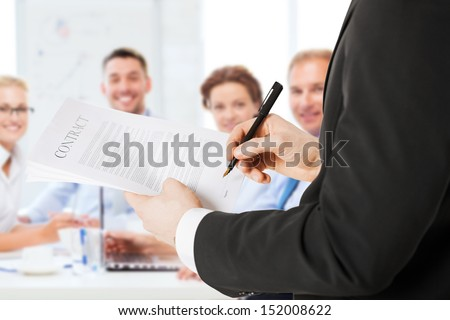 business concept - man signing contract - stock photo
