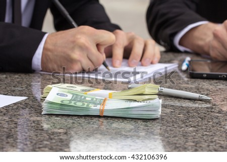 Business concept, mans hands signing papers. Selective focus - stock photo