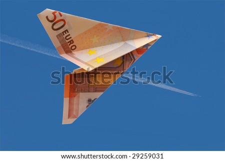 business concept. money plane on blue background - stock photo