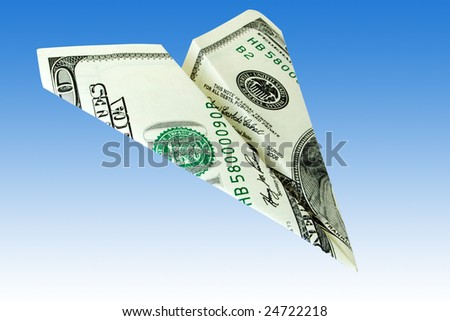 business concept. money plane over a blue background - stock photo