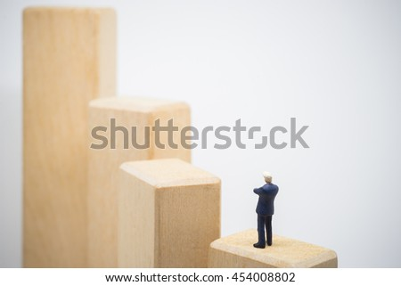 Business concept of success investment. Businessman standing and looking over wood step stair.