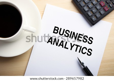 Business concept paper is on the desk with a cup of coffee and a calculator aside. - stock photo