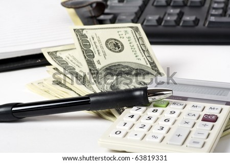 Business concept. Pen, dollars; calculator on white background - stock photo