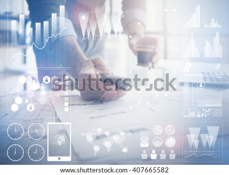 Business concept photo.Businessman working new startup project modern office.Holding contemporary smartphone hands. Worldwide connection technology,stock exchanges graphics interface. Horizontal - stock photo