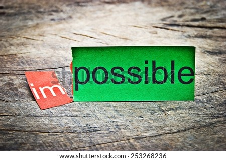Business concept photo.Changing word impossible to possible. Concepts of problem solving and overcoming challenges. (Filter image old style)  - stock photo