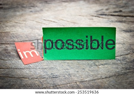 Business concept photo.Changing word impossible to possible. Concepts of problem solving and overcoming challenges. - stock photo
