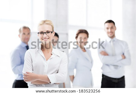 business concept - picture of smiling attractive businesswoman in office - stock photo