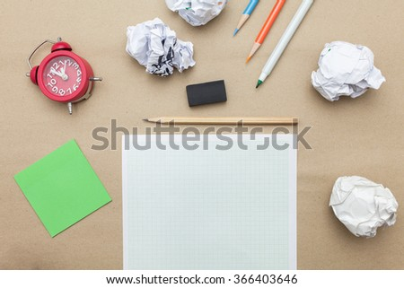 Business concept:red clock,white blank paper,crumpled paper and pencil on brown paper background - stock photo
