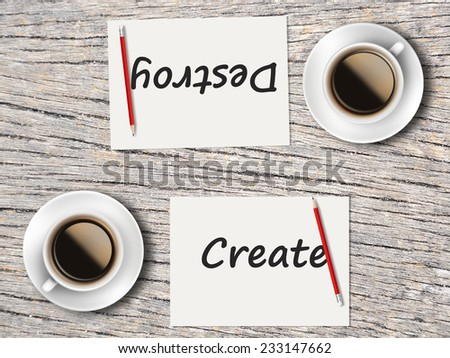 Business Concept (Rotatable) : Two Coffee, Papers And Pencils On The Table  Facing Each Other Head To Head To Compare Between Create And Destroy. - stock photo