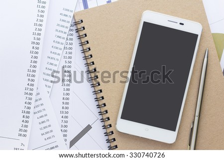 Business concept, smartphone and notebook with shopping list - stock photo