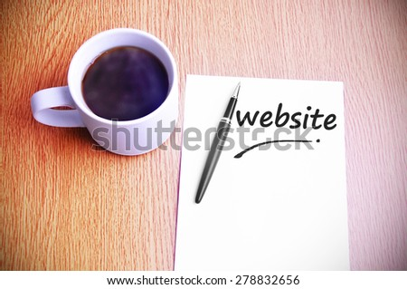 Business Concept - Steamy Coffee And Black Pen With White Paper Written Website. - stock photo